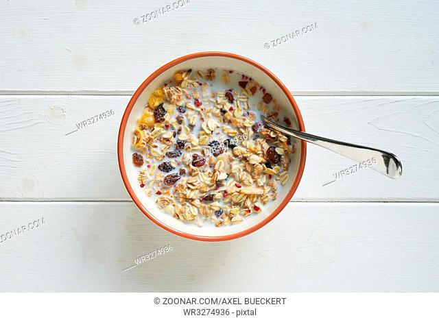 topview of bowl of muesli with milk