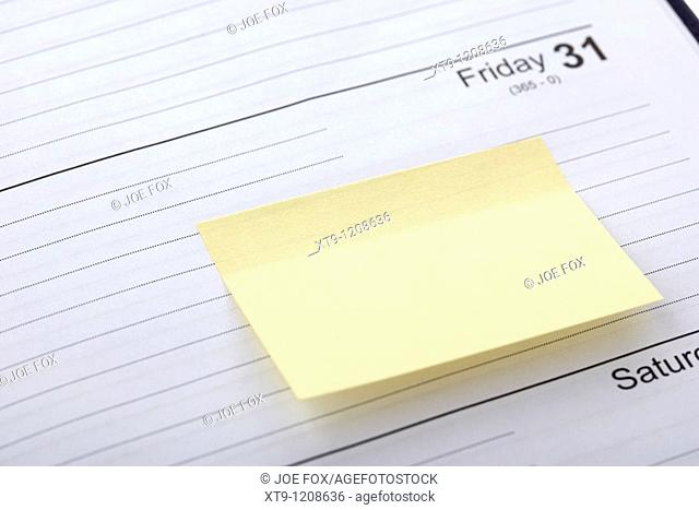 blank post-it note stuck into a diary at the end of the month