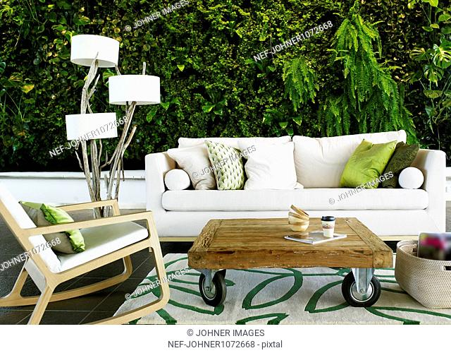 Outdoor lounge area with sofa and table