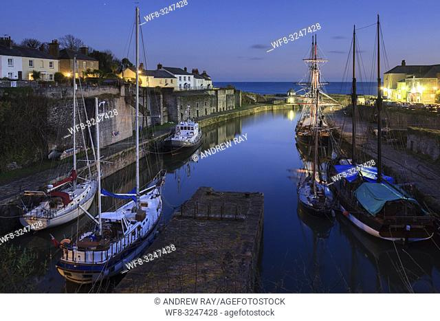 The resident tall ships in the Georgian port of Charlestown on the south coast of Cornwall, captured during twilight on an evening in mid January