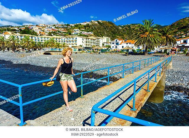 Woman in a breakwater. Beach. Santa Cruz. Madeira, Portugal, Europe