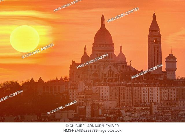 France, Paris, the Sacred Heart basilica on the hill of Montmartre at sunset