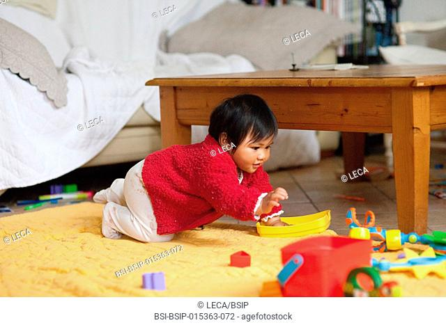 10-month old baby. This little Tahitian girl was adopted by people from the mainland of France