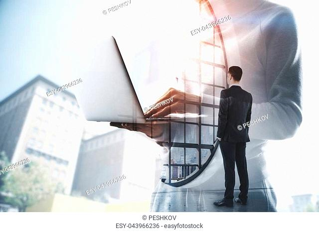 Businessman using laptop on abstract blurry office city background. Communication and network concept. Double exposure