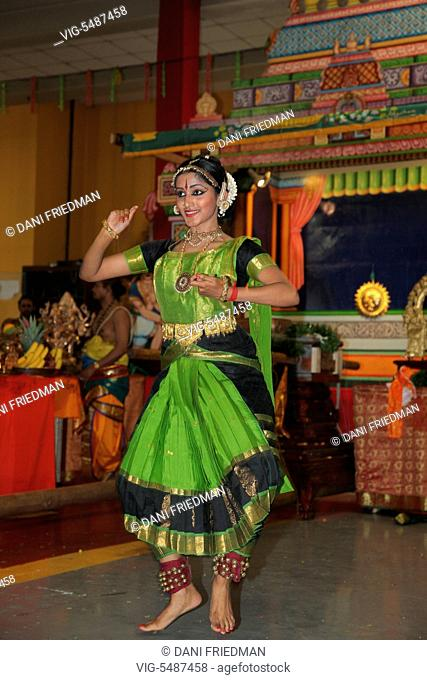 A Bharatnatyam dancer performs an expressive dance at a Tamil Hindu temple during the Ayyappan chariot festival in Ontario, Canada