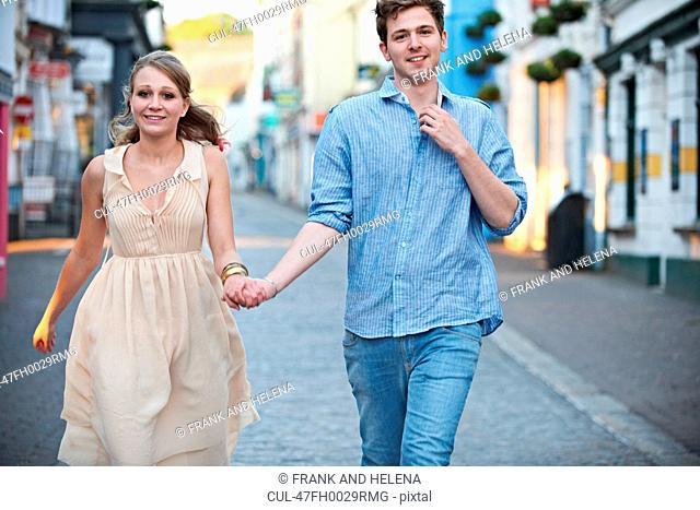 Couple walking together on city street