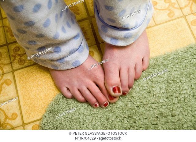 Close-up of a young woman's feet, with nail polish on her toenails