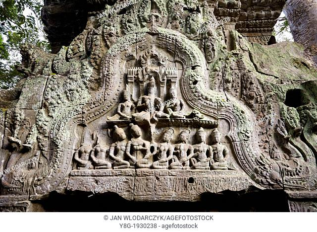Angkor - stone relief on the wall of the Ta Prohm Temple, Angkor Temples Complex, Cambodia, Asia