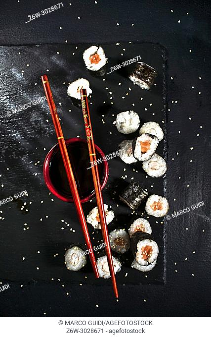 Presentation of a plate of sushi on a black slate background