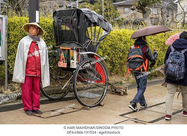 Hand rickshaw puller, kamakura, japan