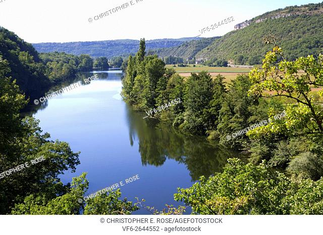 The peaceful River Lot flowing through rural countryside near Cajarc, Lot, Quercy, France, Europe