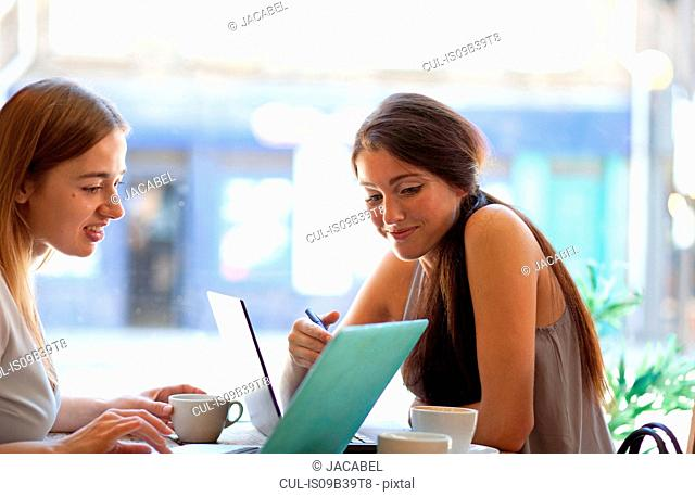 Businesswomen having meeting in coffee bar, London