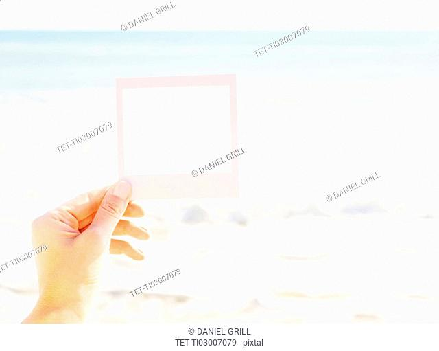 Woman holding small picture frame