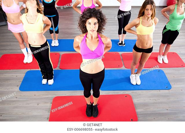 Young people in the fitness club exercising