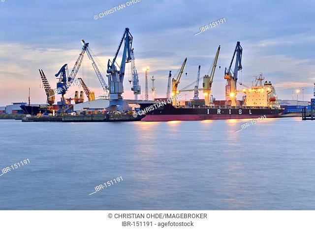 Cargo ship in the harbour, Hamburg, Germany