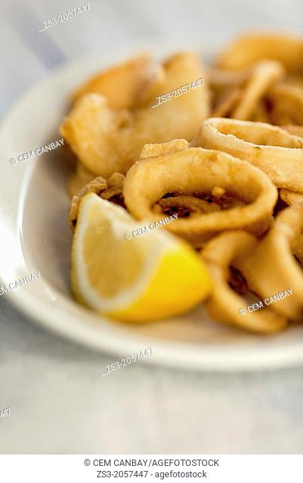 Fried Calamaries on plate served with lemon, Koufonissi, Cyclades Islands, Greek Islands, Greece, Europe