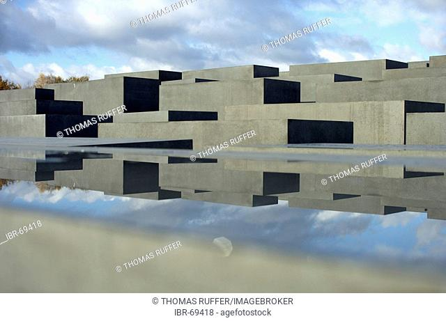Reflection of the Stele of the Holocaust memorial in a water surface on a concrete stele, Berlin, Germany