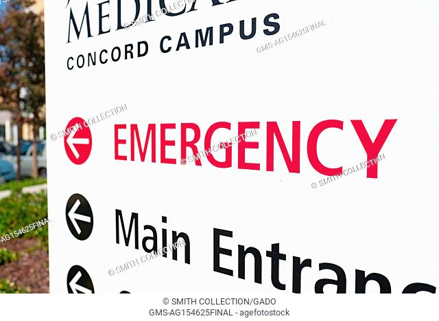 Close-up of signage for the emergency department at the John Muir Medical Center, part of the regional John Muir Health system, in downtown Concord, California