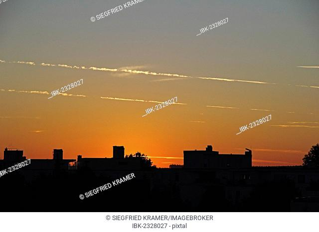Dawn with fading contrails, silhouettes of buildings, Mittelberg, Baden-Wuerttemberg, Germany, Europe