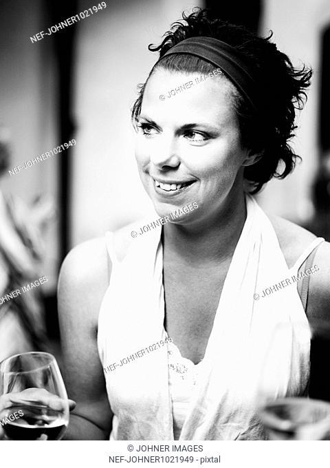 Sweden, Stockholm, portrait of mid-adult woman drinking wine