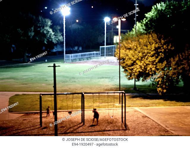 Night time playground scene, Dallas, Texas, USA