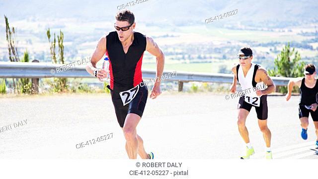 Runners in race on rural road