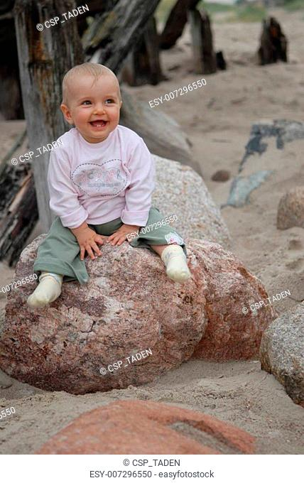 child on stone
