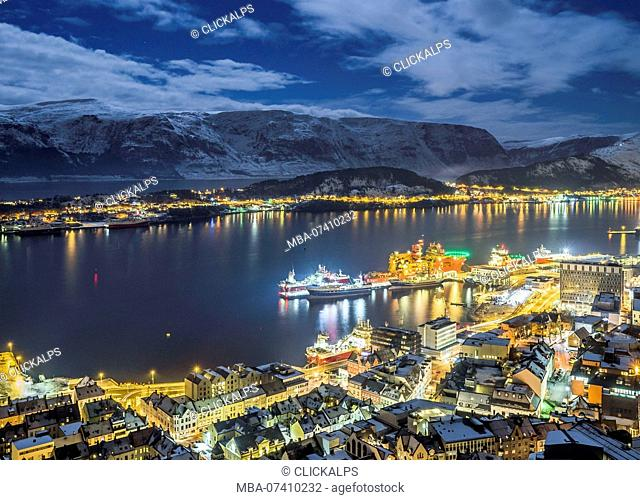 Alesund, Vestlandet, More og Romsdal county, Norway, Europe. Night view from above of Alesund port, one of most important city of Norway