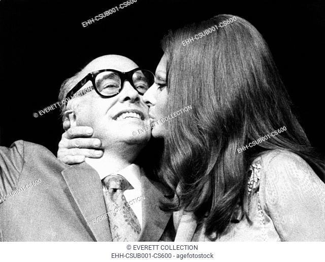 Sophia Loren gives her husband, film producer Carlo Ponti, a kiss at press conference. They were in New York to promote Sophia Loren's film SUNFLOWER, Sept