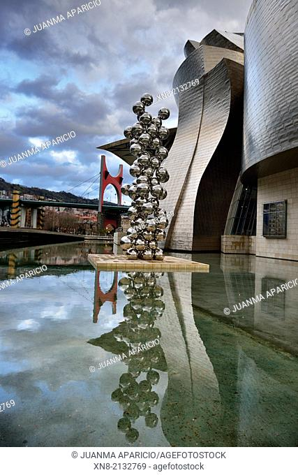 The big tree and the eye of Anish Kapoor at the Guggenheim Museum, Bilbao, Biscay, Basque Country, Spain, Euskadi, Spain, Europe