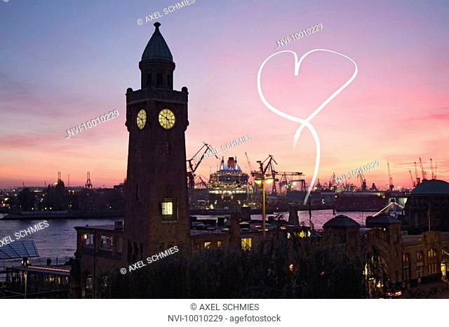Silhouette of the Landungsbruecken with lightheart and passenger cruise ship Queen Mary 2 in the shipyards, Hamburg, Germany