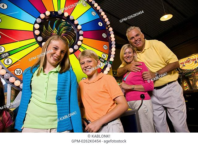 Family at an arcade game in an amusement park