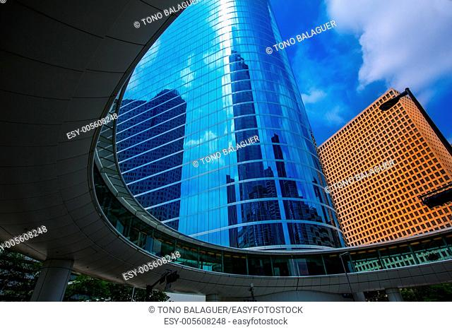 Houston downtown skyscrapers disctict with mirror blue sky reflection