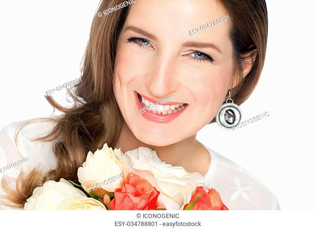 Closeup of beautiful happy bride with flowers isolated over white background