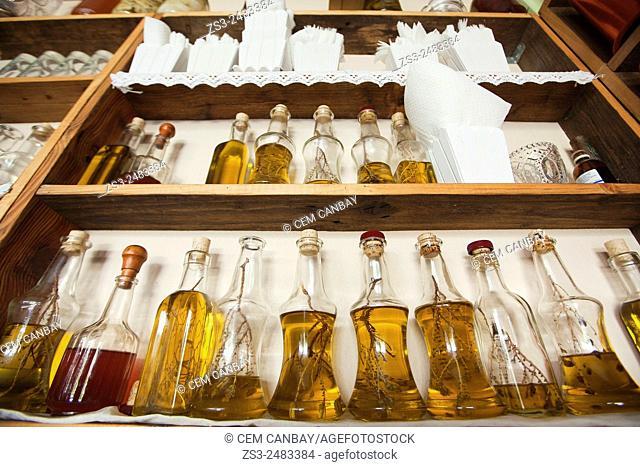Bottles of olive oil cans on the shelf, Rethymno Region, Crete, Greek Islands, Greece, Europe