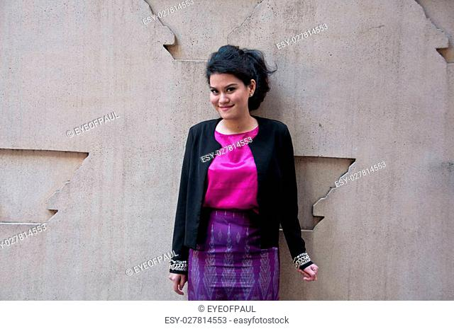 Asian business woman with Thai silk purple dress