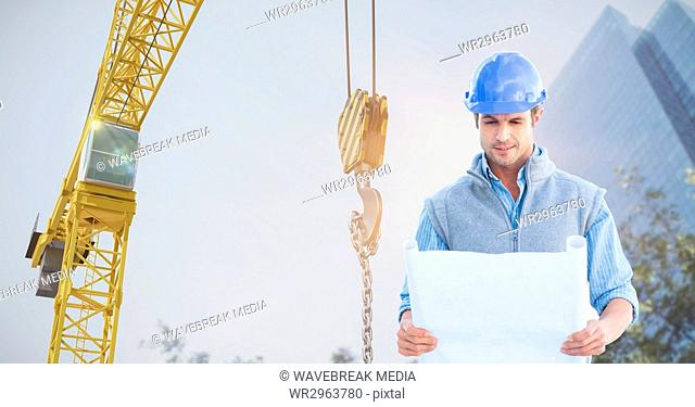 Architect holding blueprint against crane