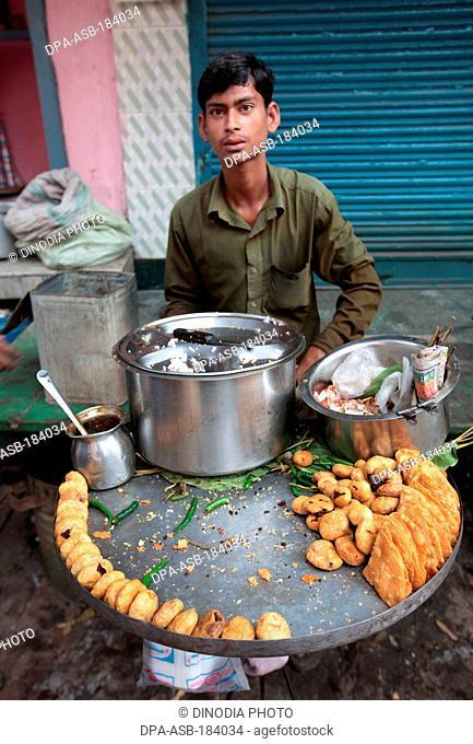 vendor selling fried snack at Varanasi Uttar Pradesh India