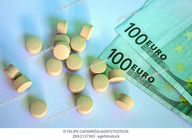 Pills and money, abstract business medical background, concept of pharmaceutical copayment