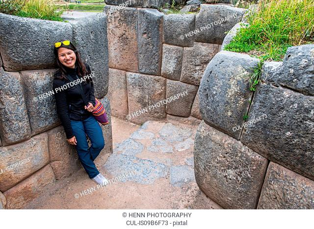 Portrait of woman at Sacsayhuaman, an ancient Inca site above Cusco, Cusco, Peru, South America