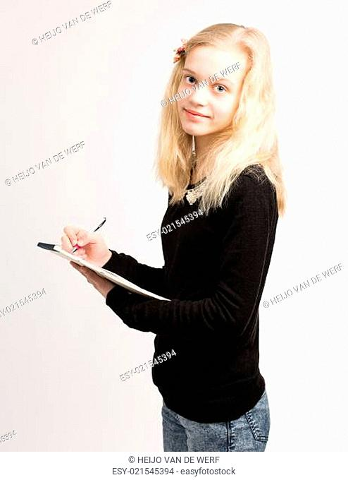 Blond Teen Girl Writing Notes On Notepad