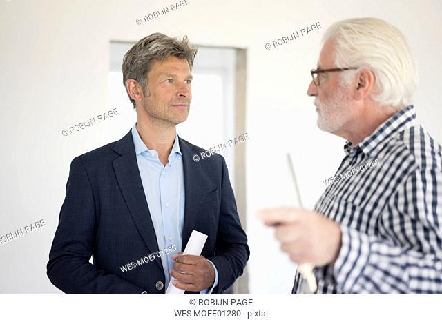 Man in suit and senior man talking