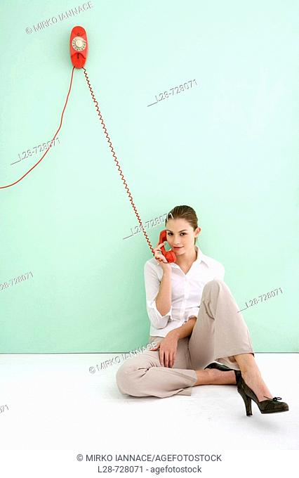 business woman using telephone