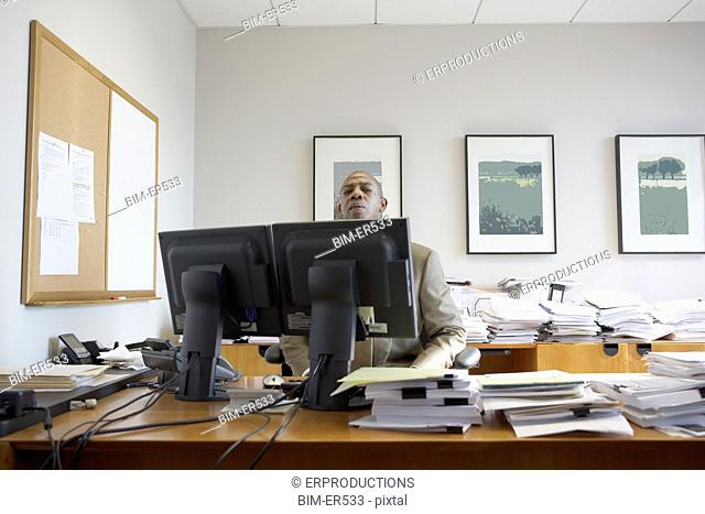 African businessman at his desk