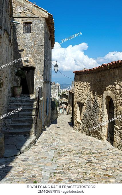 Cobblestone street in the hillside village of Lacoste in the Luberon in the Provence-Alpes-Côte d'Azur region in southeastern France
