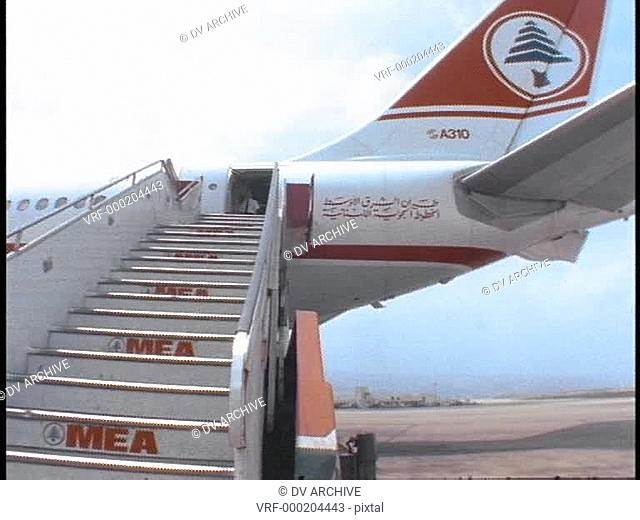 A passenger climbs the stairs to board a Middle East Airlines Airbus in Beirut, Lebanon