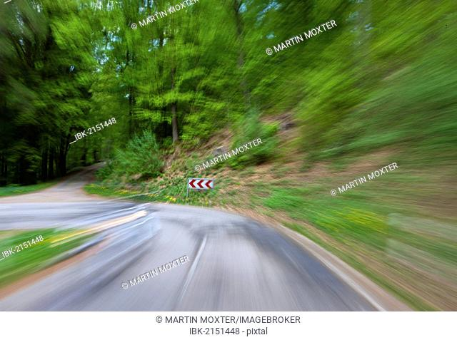 High speed motion, country road in a wooded area with a sharp left turn, Germany, Europe, PublicGround