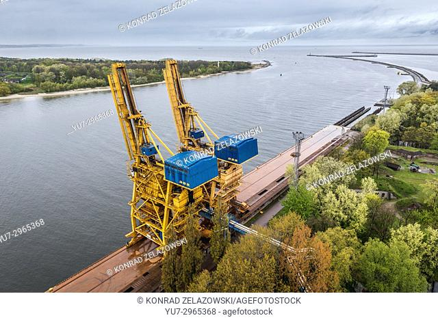 Port cranes seen from lighthouse in Swinoujscie city, West Pomeranian Voivodeship of Poland