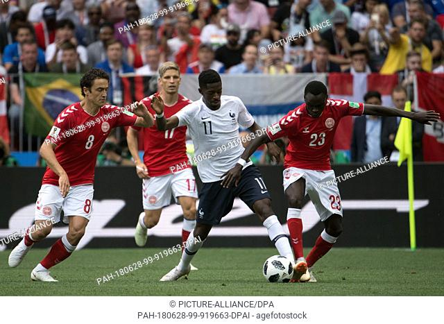 26 June 2018, Russia, Moscow, Soccer, FIFA World Cup 2018, Group C, Matchday 3 of 3 at Luzshniki Stadium: Thomas Delaney (L) and Pione Sisto from Denmark and...