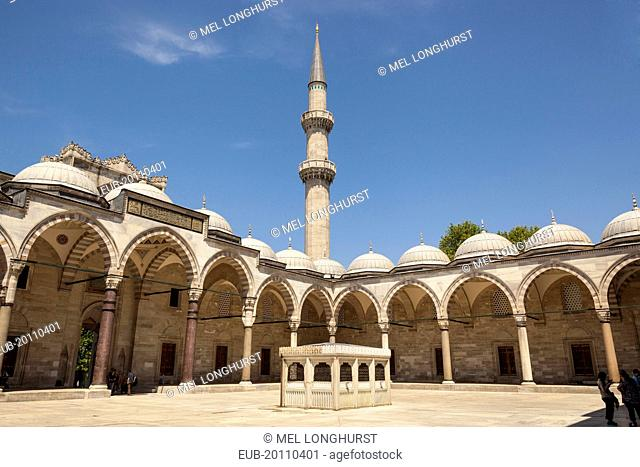 A minaret and arches Suleymaniye Mosque from the inner courtyard